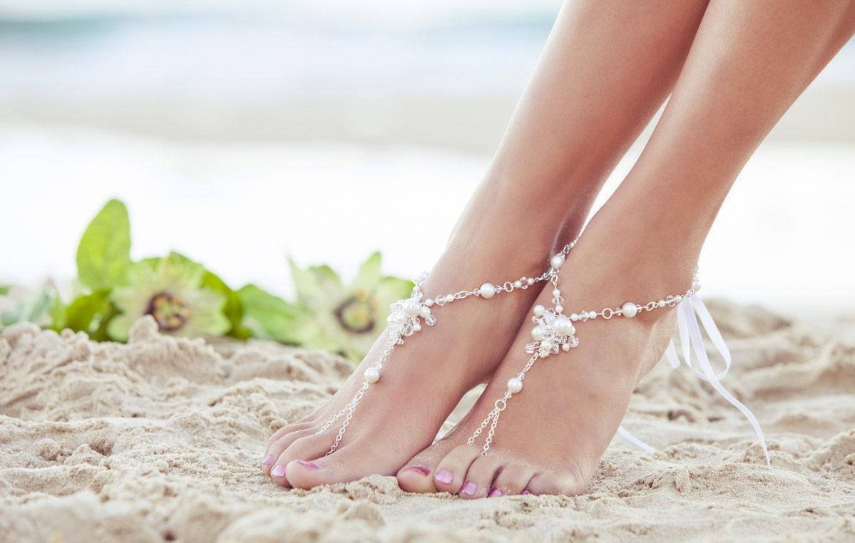 Girl Feet On The Beach